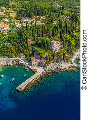 Helicopter aerial shot of beautiful small vilage and the oldest arboretum Trsteno near Dubrovnik, a location of filmng Games of Thrones.