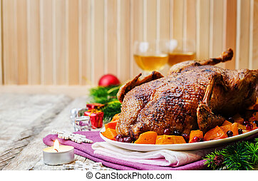 Duck baked with apples, pumpkin and cranberries