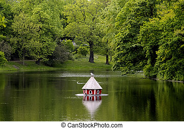 Duck house on lake