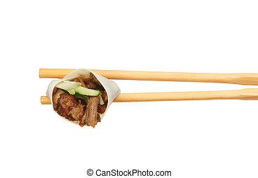 Duck roll in chopsticks