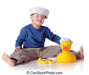 Ducky Sailor - A preschooler playing with a large rubber...