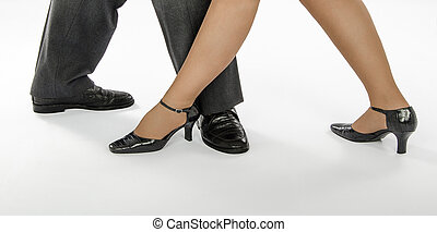 Dude and lady are dancing - Pair feet in crocodile skin...