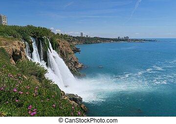 Duden Waterfall and the City of Antalya in Turkey - Duden...