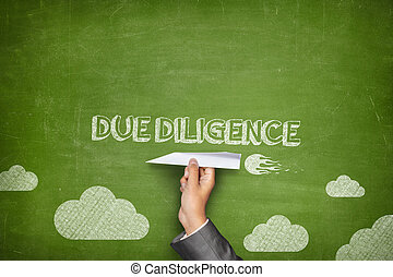 Due diligence concept on blackboard with paper plane