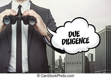 Due diligence text on speech bubble with businessman holding binoculars
