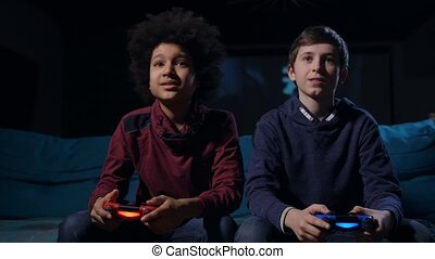 Duel between best friends playing shooter game - Diverse...