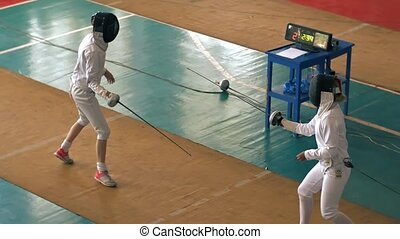 Duel of fencers on competition - Duel of two fencers on...