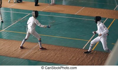 Duel of two fencers on competition