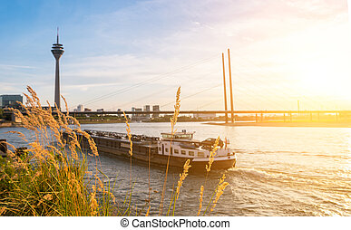 Duesseldorf skyline at sunset at the rhine river