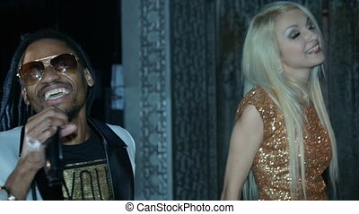 Duet African American man and a blonde woman singing