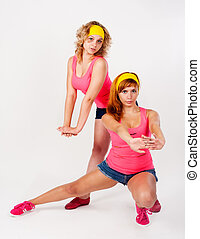 Duet of pretty girls dancing