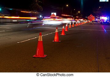 Traffic cones and traffic at a DUI check point in Anaheim.