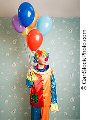 Dull clown with a bunch of balloons.