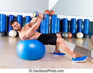 Dumbbell bench press on fit ball man workout at  gym