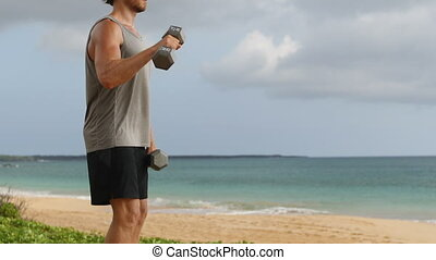 Dumbbell Bicep Curl exercise - fitness man exercising doing Reverse Grip Biceps Curls. Unrecognizable fit sport fitness model showing dumbbell weight lifting workout. REAL TIME.