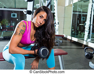 dumbbell concentrated biceps curl girl woman