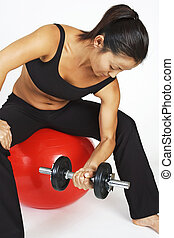 Dumbbell Curl 3 - A female fitness instructor demonstrates a...