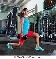 dumbbell lunge woman exercise at gym - dumbbell lunge woman...