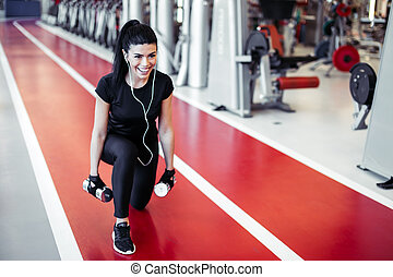 dumbbell lunge woman workout exercise, one leg split squats