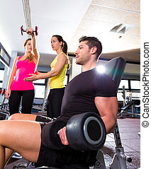 Dumbbell man at gym workout fitness weightlifting