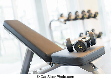 dumbbell on the exercise bench