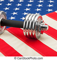 Dumbbell weights above US flag as symbol of healthy nation -...