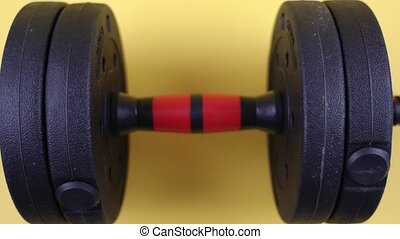 Dumbbell with gym weights on yellow background - Dumbbell ...