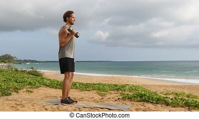 Dumbbells Biceps Curls exercise - fitness man exercising arms on beach. Fit male sport fitness model showing bicep curl weight lifting workout exercise with dumbbell. SLOW MOTION.