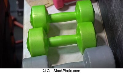 Dumbbells in gym. Fitness sports concept