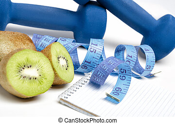 dumbbells, kiwi and water