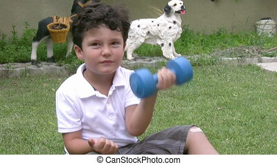 Dumbbells - Little boy working with dumbbells