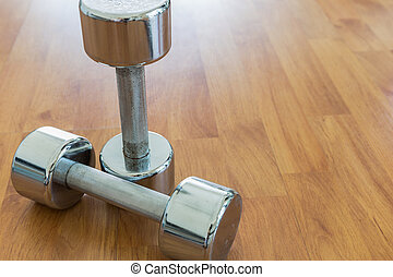 Dumbbells on Wooden Floor