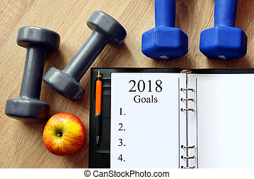 Healthy resolutions for the New Year 2018. - Dumbbells with...