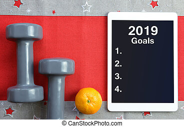 Healthy resolutions for the New Year 2019. - Dumbbells with...