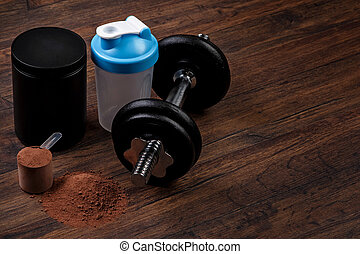 Dumbell and protein powder - Heavy black dumbell and protein...