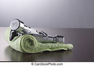dumbell and towel