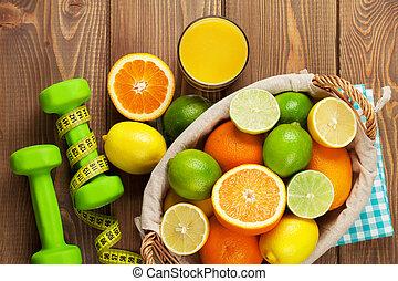 dumbells., cales, fruta cítrica, limones, fruits, cesta,...