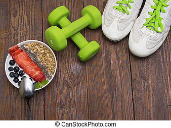 Dumbells, tape measure and healthy food. Fitness