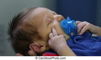 Dummy and hands moving a newborn trying to sleeping