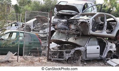 Dump old cars. - Broken car in the junkyard.
