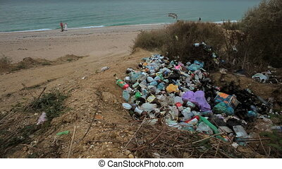 Dump plastic near the sea - A large pile of debris lay...