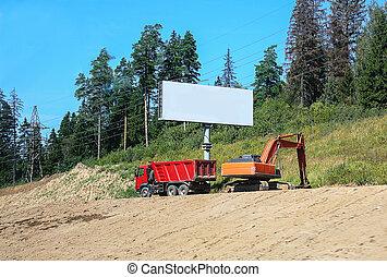roadwork - dump truck and the excavator on roadwork