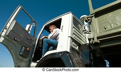 Dump Truck Driver On The Phone
