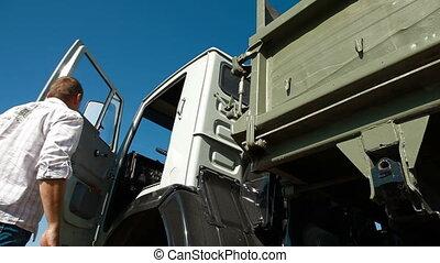Dump Truck Driving - Driver Driving Dump Truck