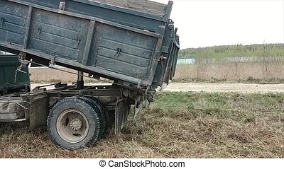 Dump truck dumper lorry dumping rubble load