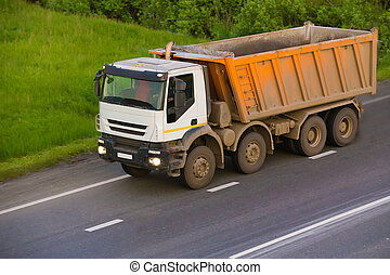 dump truck goes on country highway - big dump truck goes on...