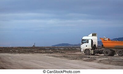 Dump truck - Heavy duty dump truck works for formation of...