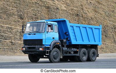 Modern blue dump truck in the opencast mine