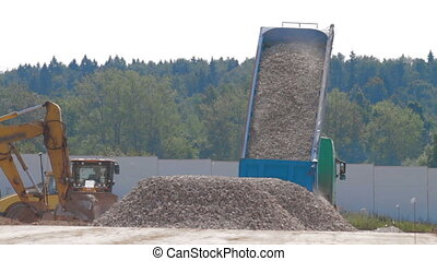 Dump Truck unload gravel on construction site
