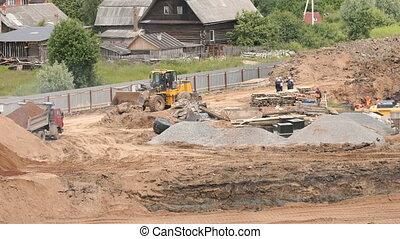 Dump truck unload pit sand into large pile of sand